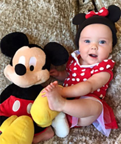 baby-dressed-with-mickey-mouse